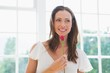 Thoughtful beautiful woman holding flower