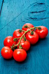 fresh tomatoes on branches
