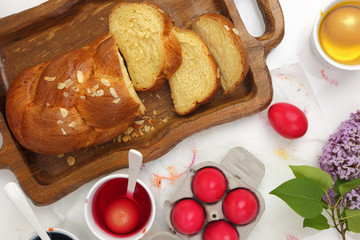 Easter sweet brioche, red eggs and liquid dye