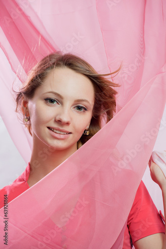 Portrait the girl with a pink veil