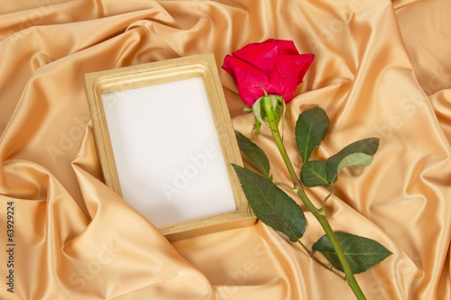Empty photoframe with rose