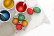 Colored Easter eggs and liquid color dyes on white background
