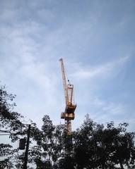 high crane in blue sky