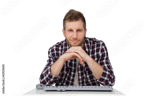 Portrait of a handsome young man with keyboard