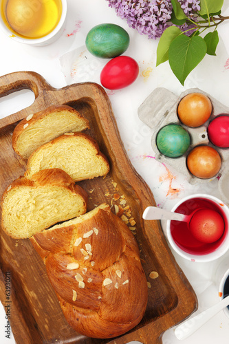 Easter sweet brioche, colored eggs and liquid dye