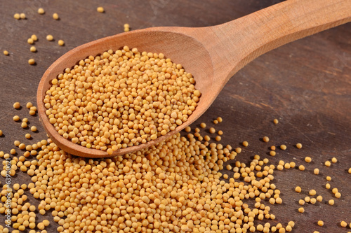 White mustard seeds in a spoon