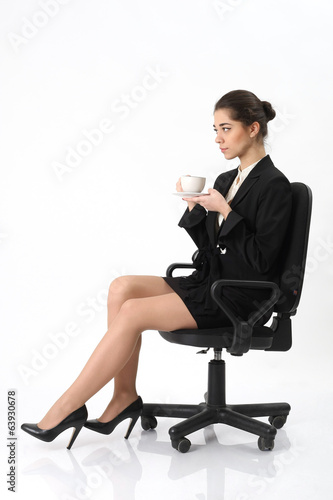 Business woman sitting in an office chair