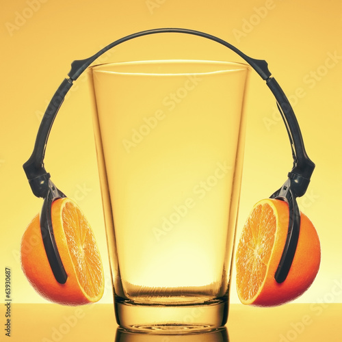 Headphones made of orange slices and a glass