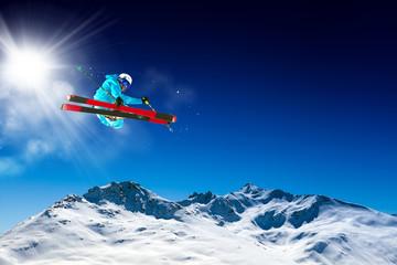 ski in blue sky