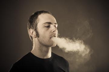 Man exhales smoke.