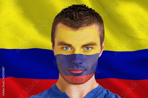 Composite image of serious young colombia fan with facepaint