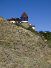 Villa with a tower in the mountains in Crimea