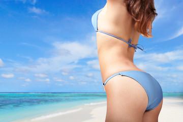 young woman in sexy bikini at the beach