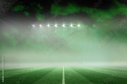 Football pitch under green sky