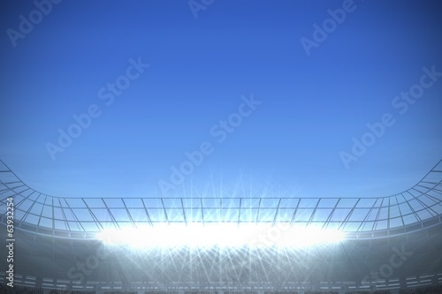 Large football stadium under bright blue sky