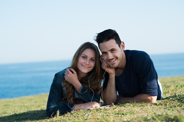 happy young couple on holiday by the sea in summertime