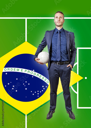 businessman with soccer ball on a brazil flag