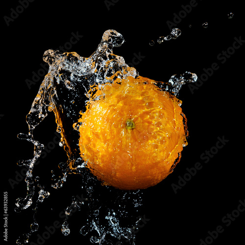 Fresh orange in water splash