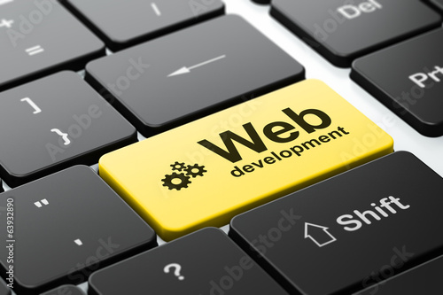 Web development concept: Gears and Web Development on computer