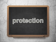 Protection concept: Protection on chalkboard background