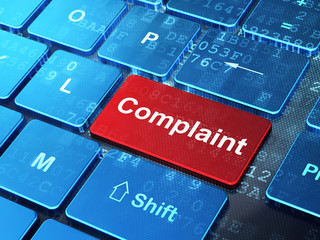 Law concept: Complaint on computer keyboard background