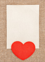 Felt red heart and canvas on the burlap