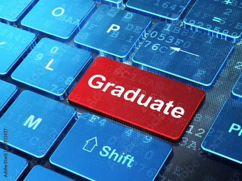 Education concept: Graduate on computer keyboard background