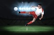 Composite image of fit football player playing and kicking