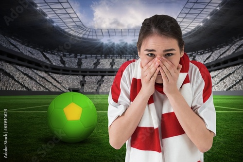Composite image of nervous football fan looking ahead