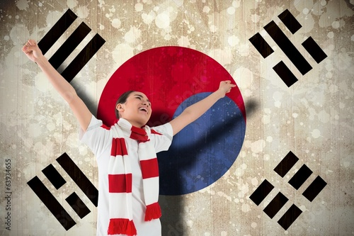 Composite image of excited asian football fan cheering