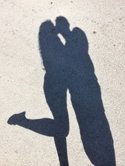 The shadow of a girl kissing a boy