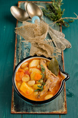 Rabbit stew with potatoes and carrots