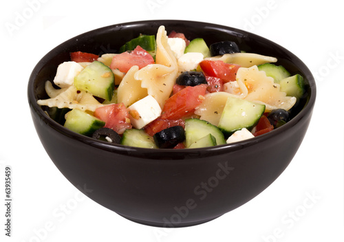 greek salad bowl over white background