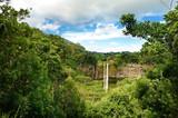 Fototapety Scenic Chamarel falls in jungle of Mauritius