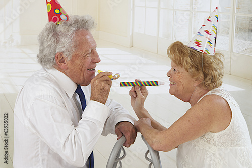 Portrait of an elderly couple in festivity