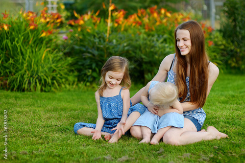 Young mother and her two little daughters