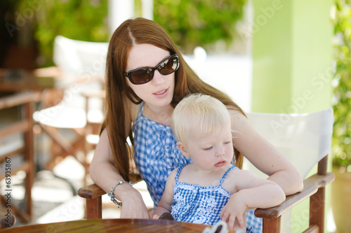 Mother and daughter relaxing in restaurant