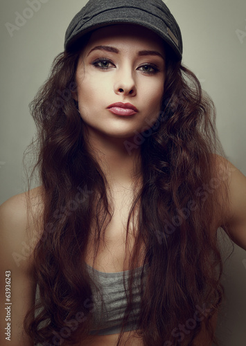 Vintage portrait of trendy girl in fun hat. Closeup