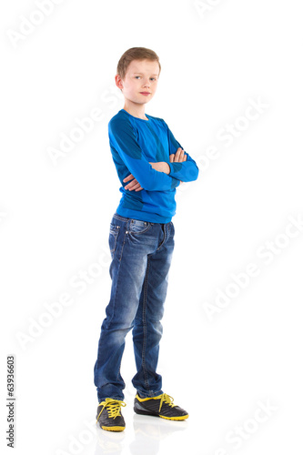 Boy posing with arms crossed.