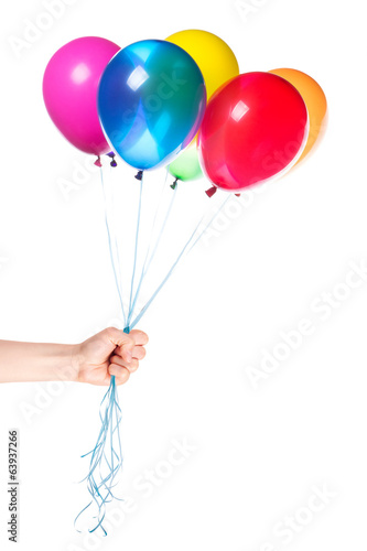 human hand gives flying balloons