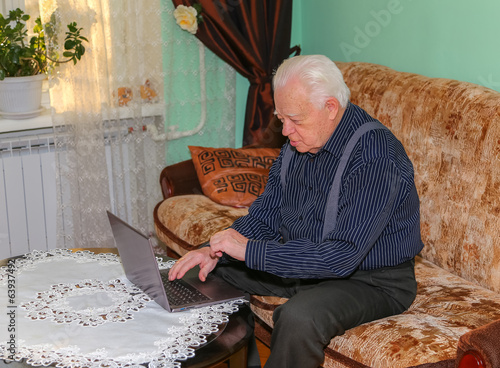 Aged grandfather with notebook