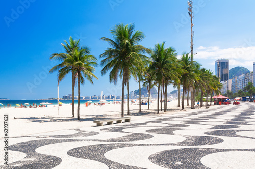 Copacabana with palms and mosaic of sidewalk in Rio de Janeiro - 63937621