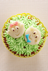Cupcake decorated with baby faces