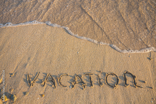 Word Vocation write on white sand