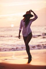Beautiful girl on the beach at sunset