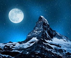 Matterhorn in night sky with moon - Swiss Alps