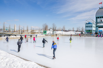People Having Fun on the Ice Rink