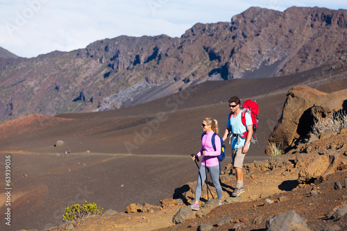 Hikers enjoying walk on amazing mountain trail