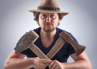 Man with crossed tools