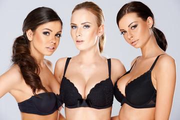 Three beautiful women modeling black lingerie